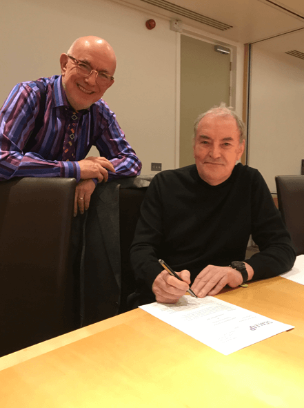 ScaleUp Chairman, John O'Connell and TechMarketView Managing Partner, Anthony Miller signing the agreement